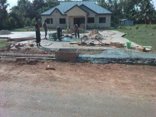 Workers preparing the compound