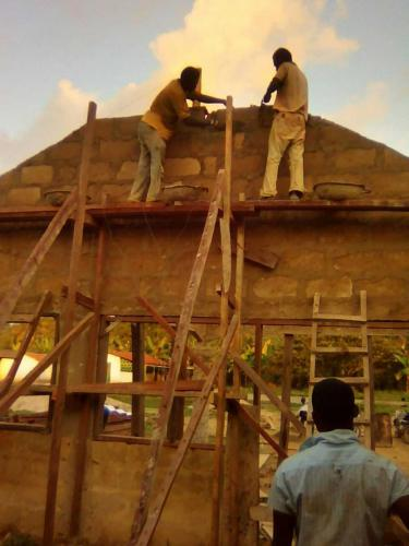 workers on roofing level